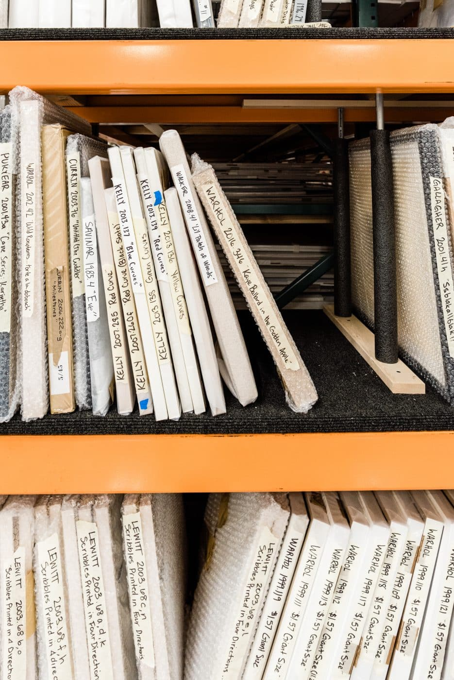 Warehouse shelves storing art from the collections of Schnitzer and the Jordan Schnitzer Family Foundation.