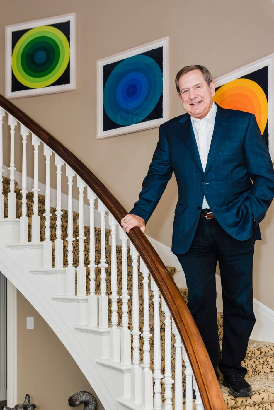Jordan Schnitzer's home in Portland, Oregon: Schnitzer on his staircase with On Target, 2019, by Polly Apfelbaum