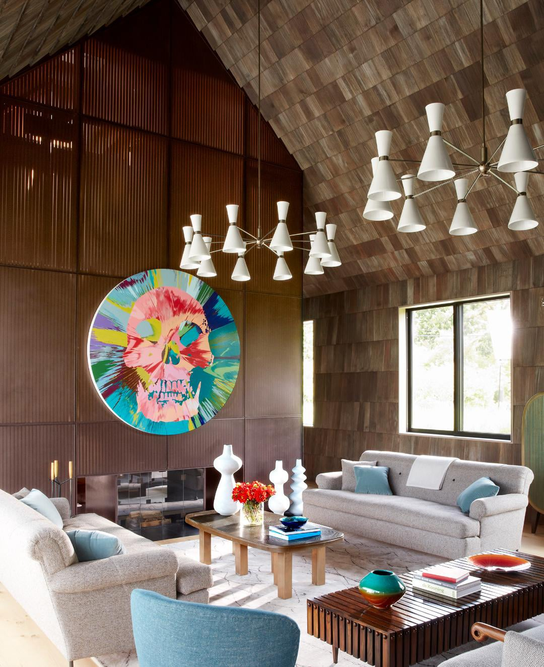 Interior of a Hamptons beach house, designed by Damon Liss and decorated with with tall black-and-white vessels by Lone Skove Madsen