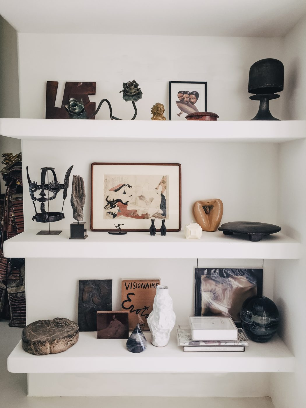 Shelf with artwork and sculpture pieces