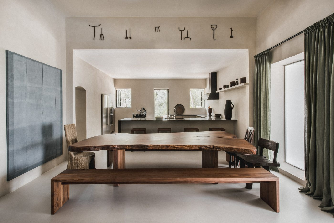 Dining room designed by Hollie Bowden featuring a walnut table