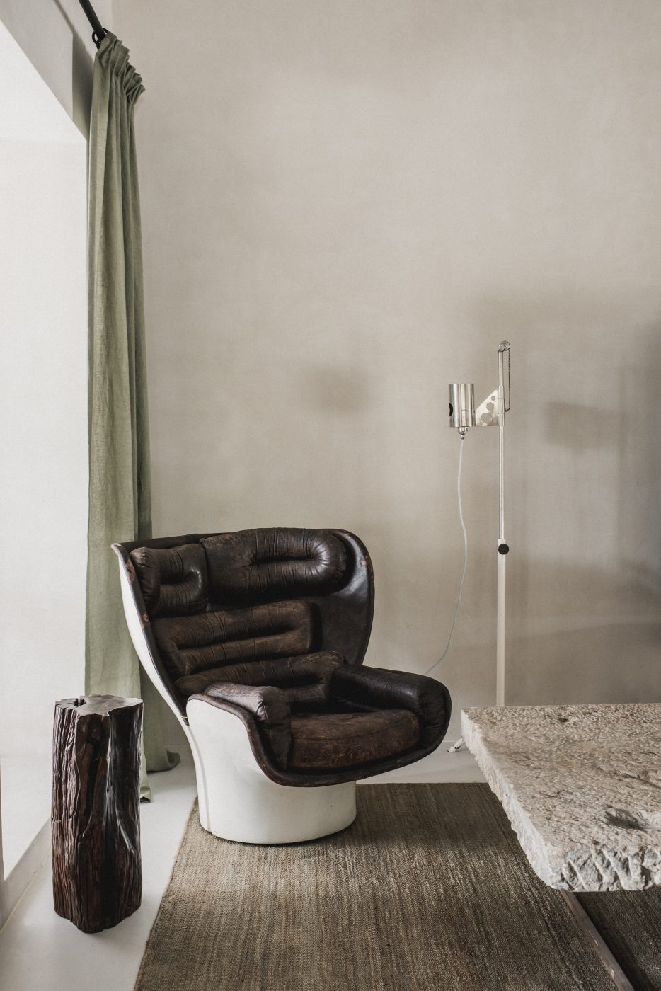 A Joe Colombo Elda Chair in a living room designed by Hollie Bowden