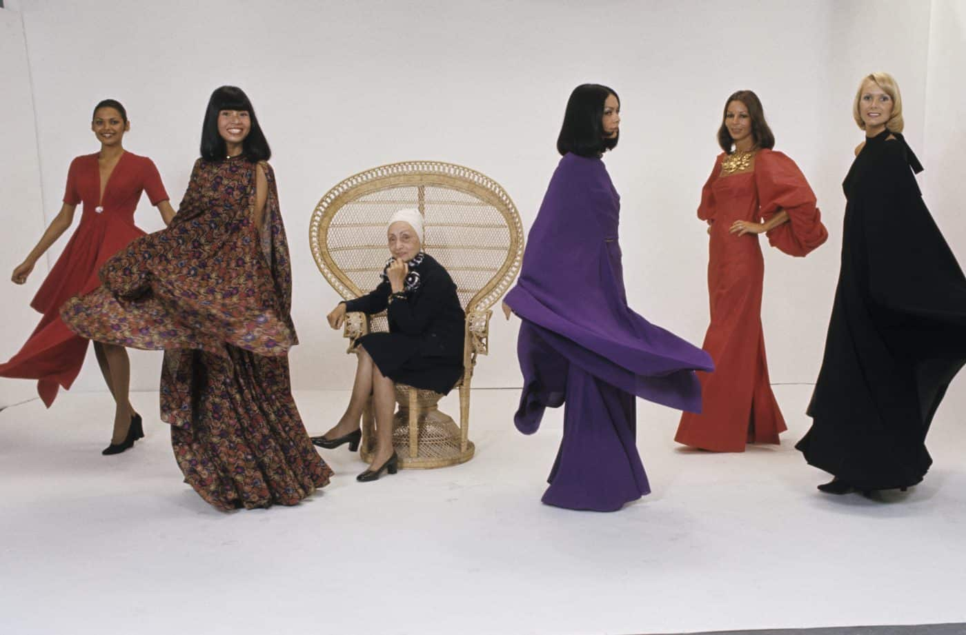 photo of Madame Grès at her Paris boutique amongst models wearing her designs