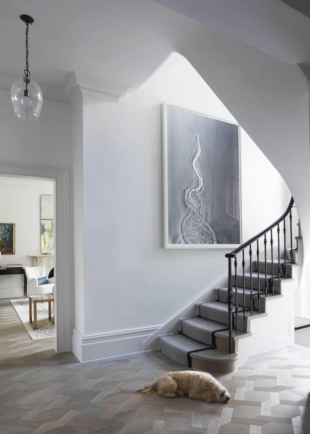 Holland Park stair hall featuring Adam Fuss artwork