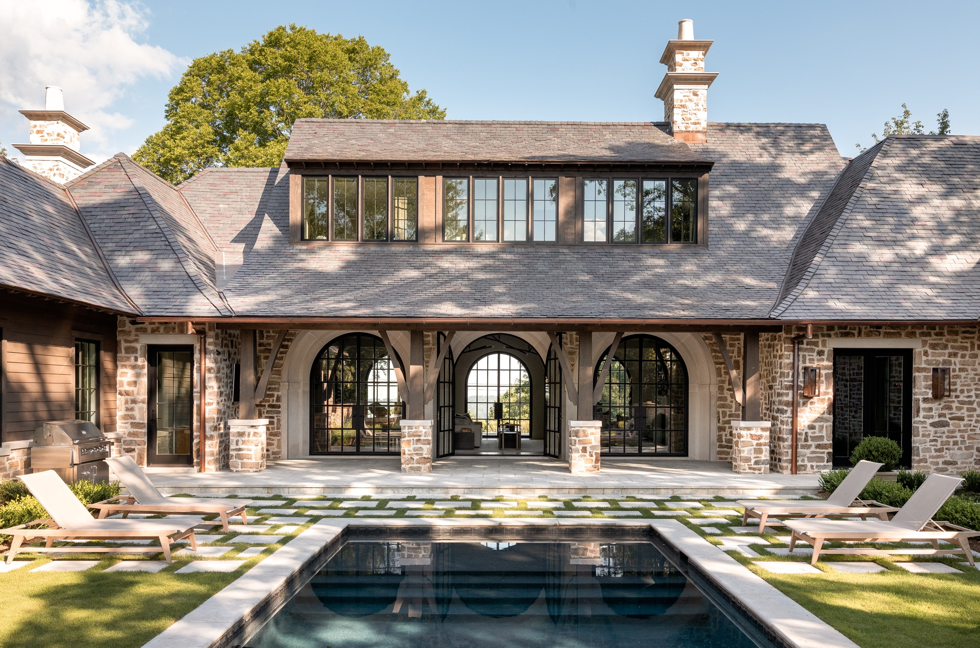 Exterior shot of a Vestavia Hills home with a pool and a pool deck