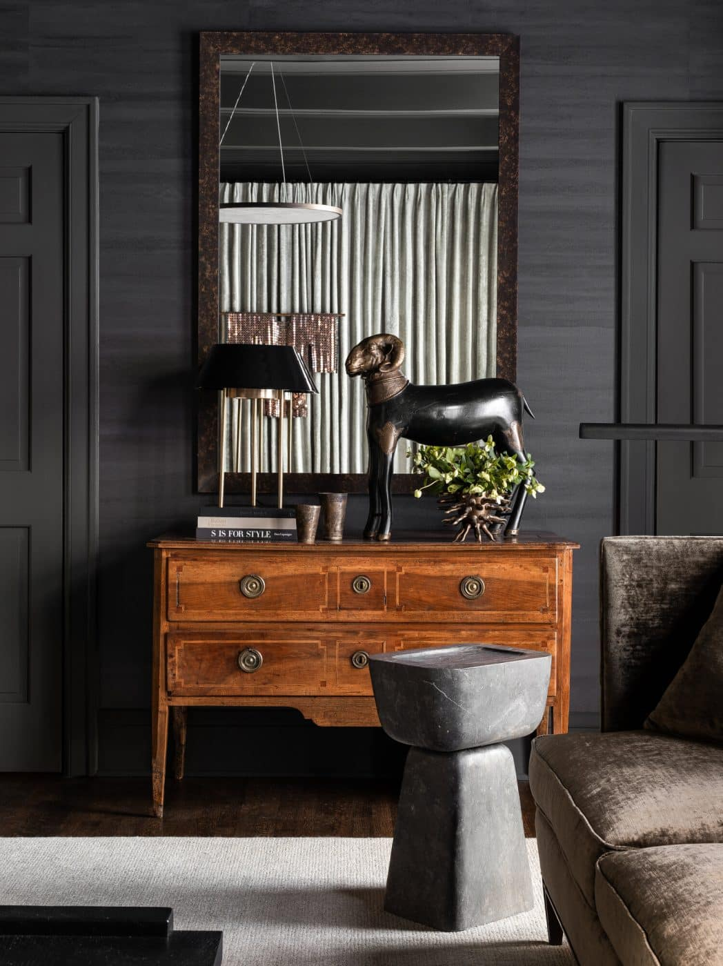 Commode details in a living room designed by Sean Anderson