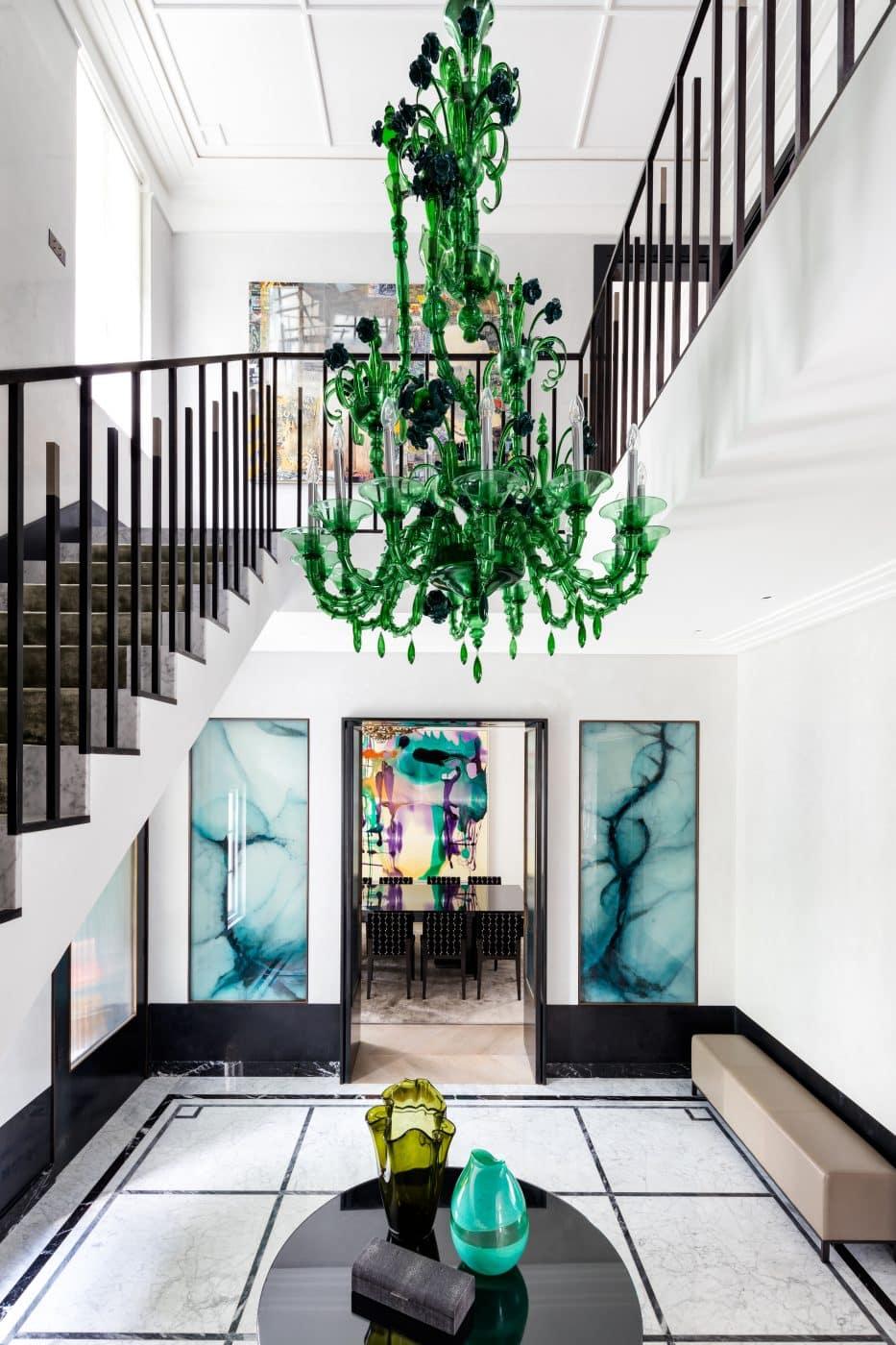 Foyer featuring a green chandelier