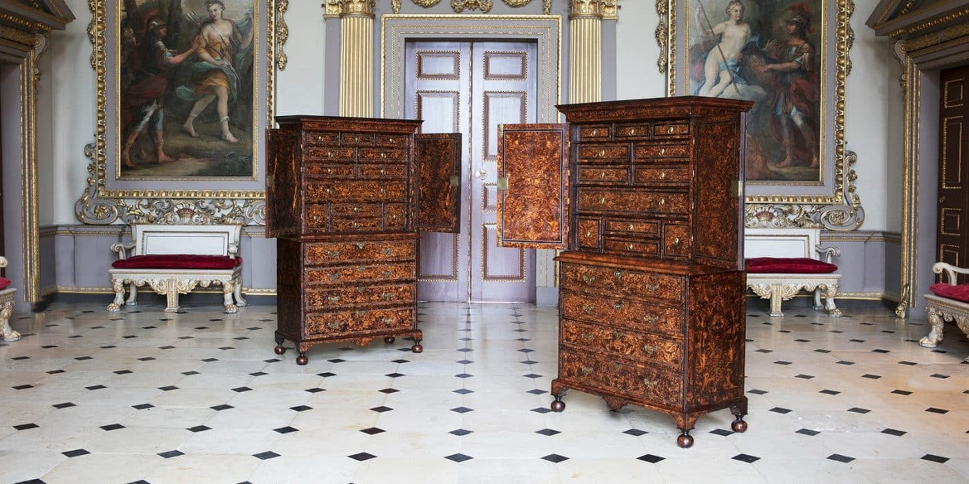 A pair of ca. 1719 Coxed and Woster mulberry secretaries is made from burr maple treated to highlight its whorled grain