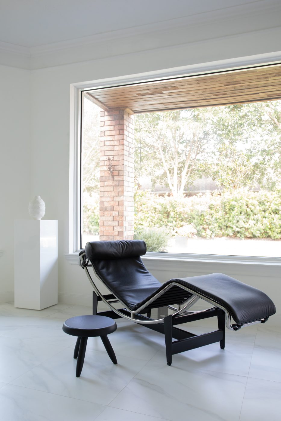 Recliner chair with side table in Mateo's Houston home