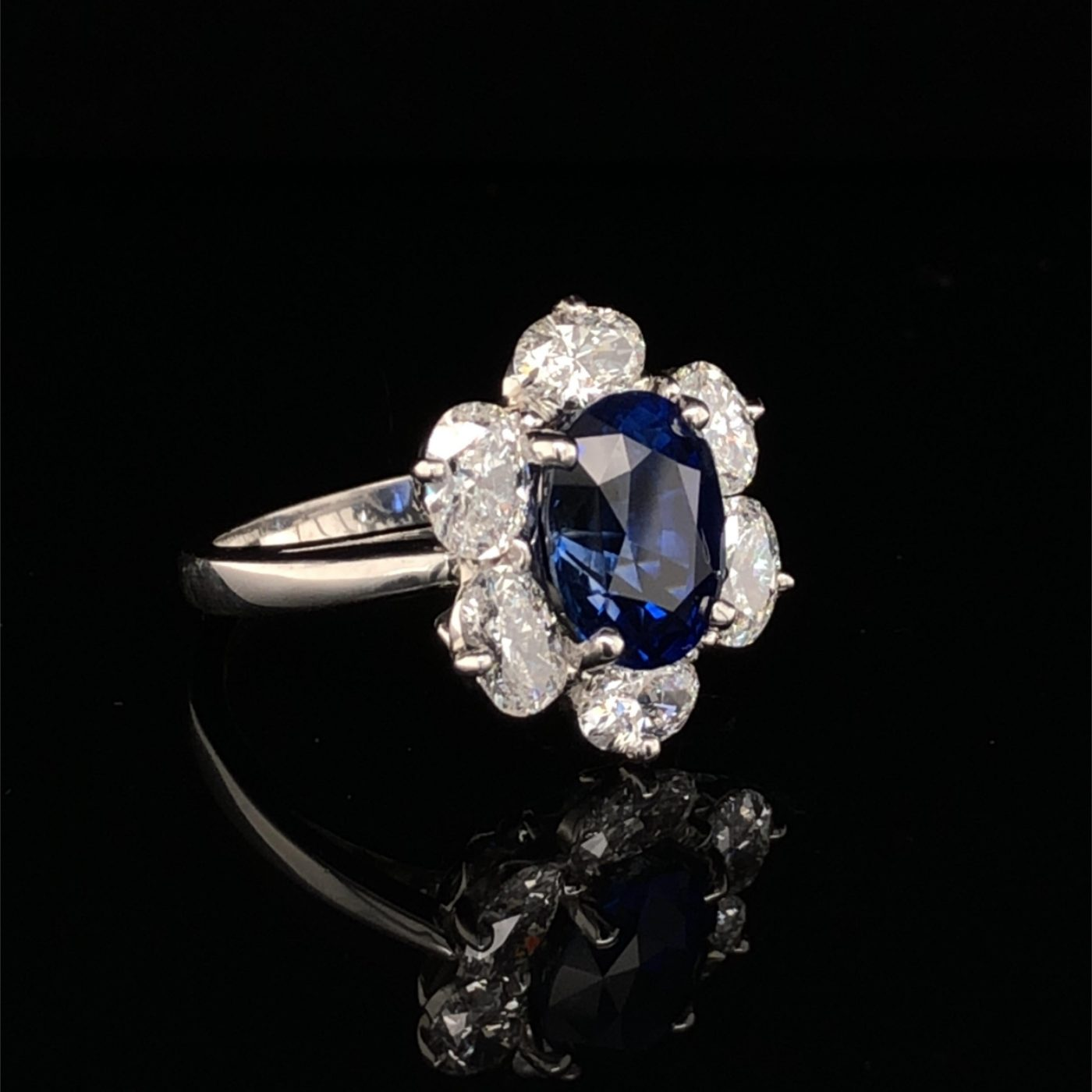 An Oscar Heyman Platinum 4.04ct Royal Blue Sapphire Entourage Ring