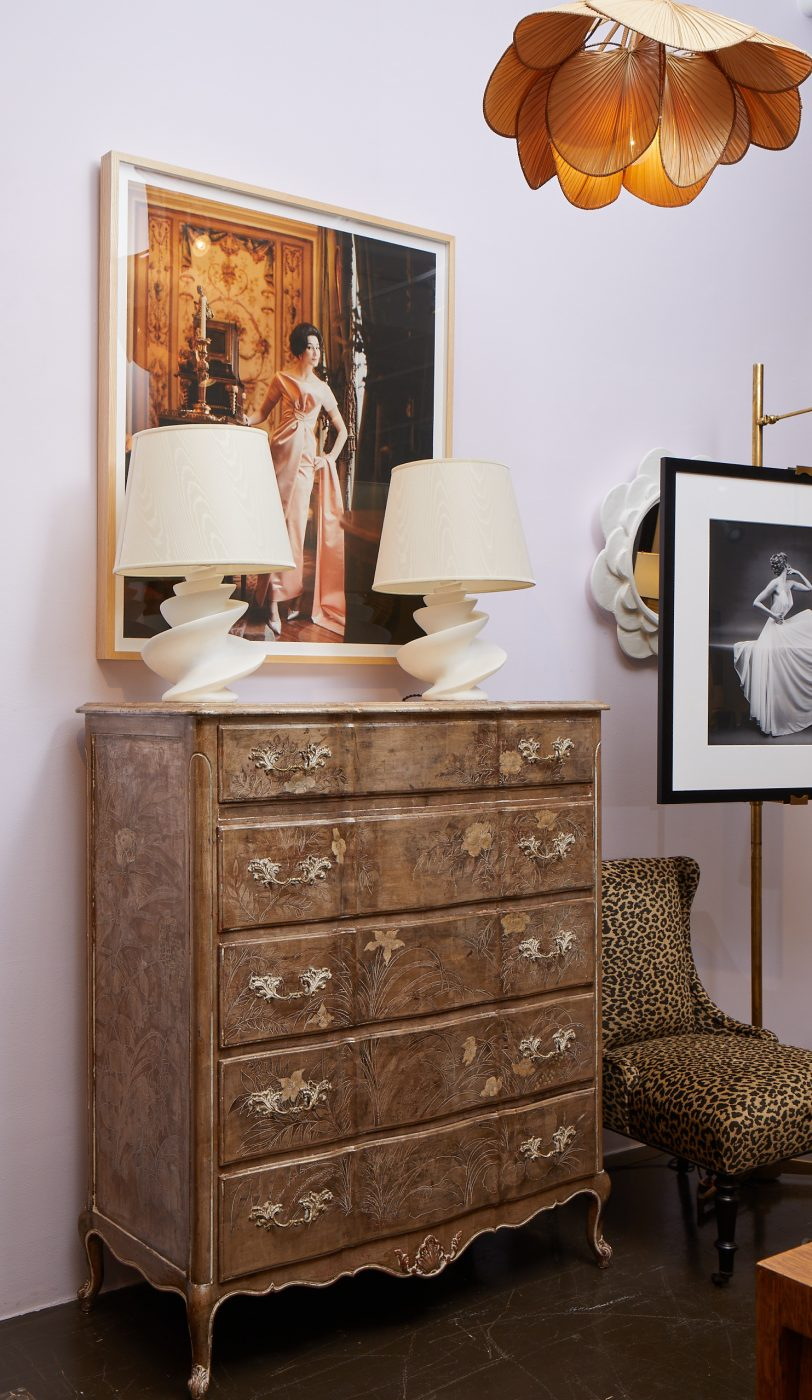 Dresser with matching lamps and framed artwork