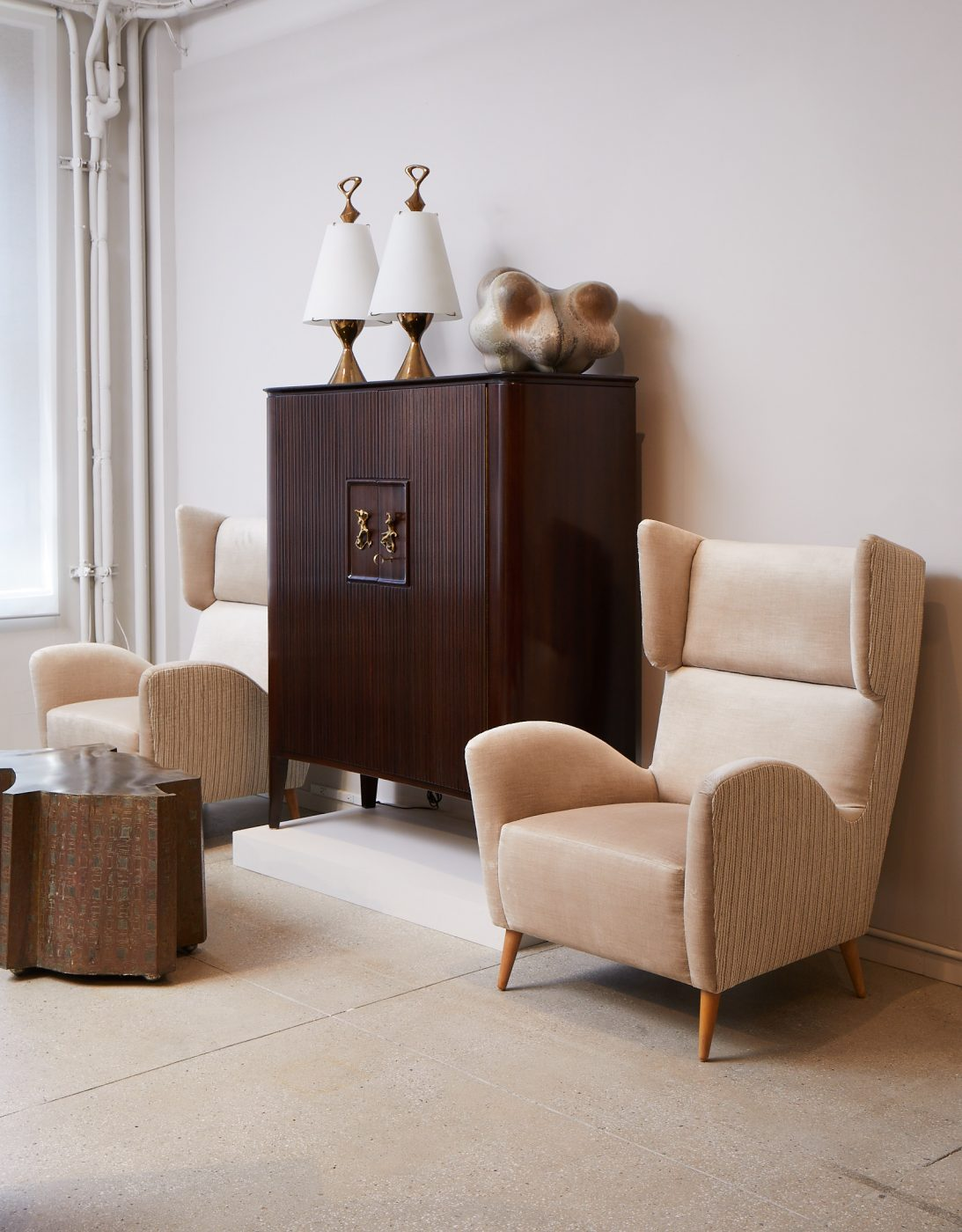 Matching arm chairs next to a wooden console