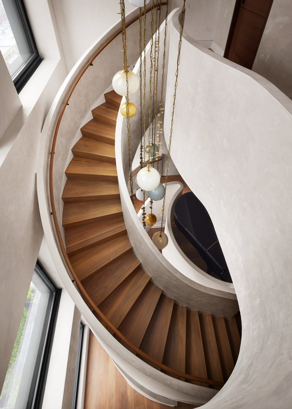Sculpture spiraling set of stairs in the Manhattan triplex designed by DHD