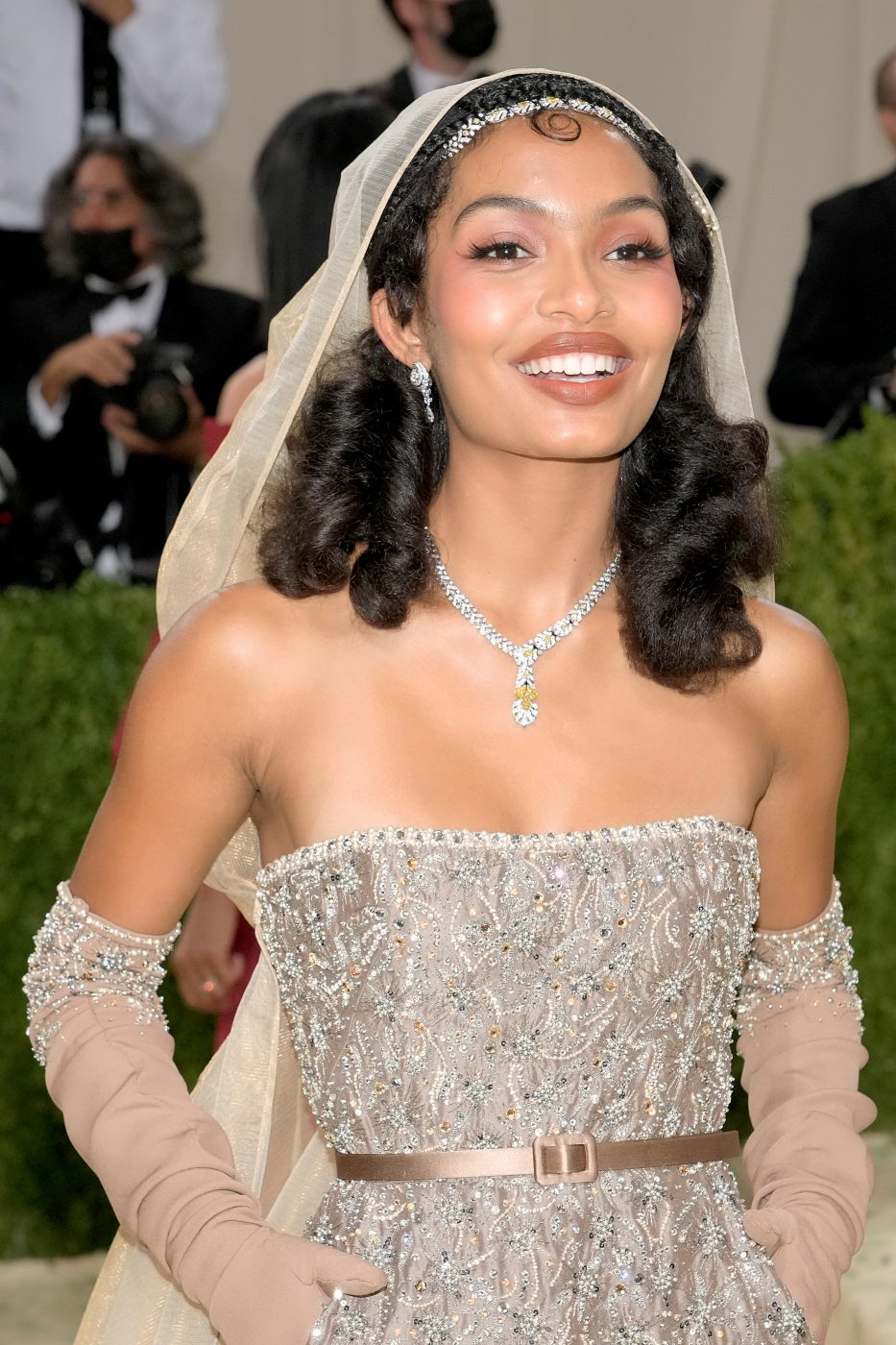 Yara Shahidi, in a Dior dress, wears Cartier earrings, a necklace with yellow diamonds, white diamonds and onyx and a necklace with yellow and white diamonds as a headband at the 2021 Met Gala in New York