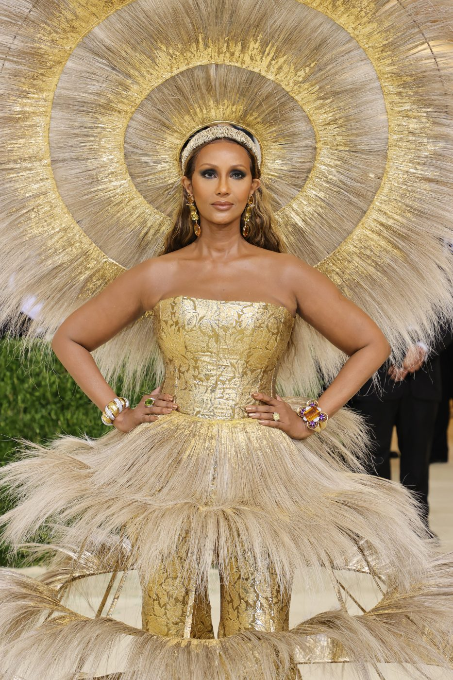 Iman accessorized her Harris Reed gown and headdress with jewelry that included a 13-carat yellow diamond ring by Kwiat