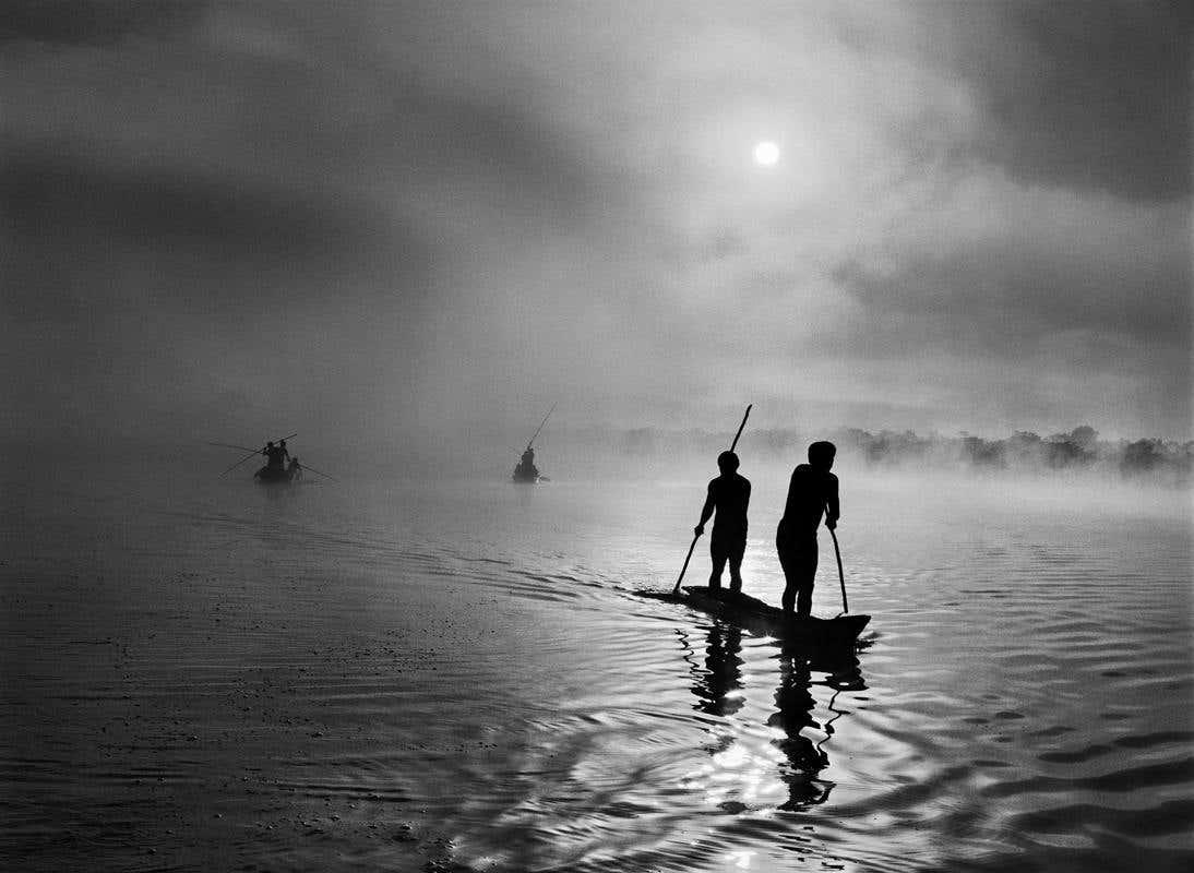 Sebastião Salgado: Fishing in the Piulaga Laguna during the Kuarup ceremony of the Waura Group, Upper Xingu Basin, Mato Grosso, Brazil, 2005