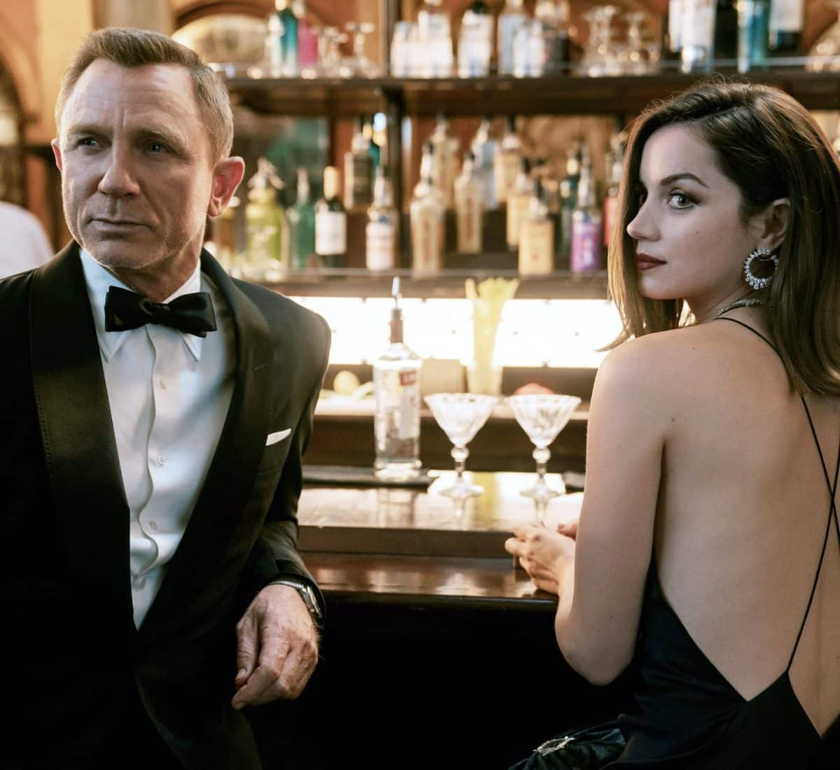 In this fall's No Time to Die, Daniel Craig's Bond pairs his tuxedo with an OMEGA SEAMASTER and a martini in a scene with Ana de Armas.